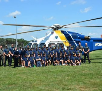 New Jersey State Police hand their helicopter at the Monroe Township Middle School to show the first ever Monroe Township Police Youth Academy class