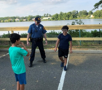 Ofc. Cohn showing children beer goggles
