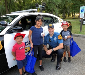 Ofc. Mosakowski showing local children our police car