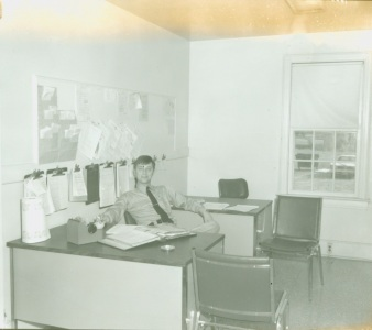 Monroe Police Officer sitting in the old police headquarters