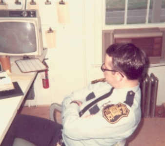 An officer sitting in the Dispatch Room in 1974 at the Police Station Located on Spotswood Englishtown Road